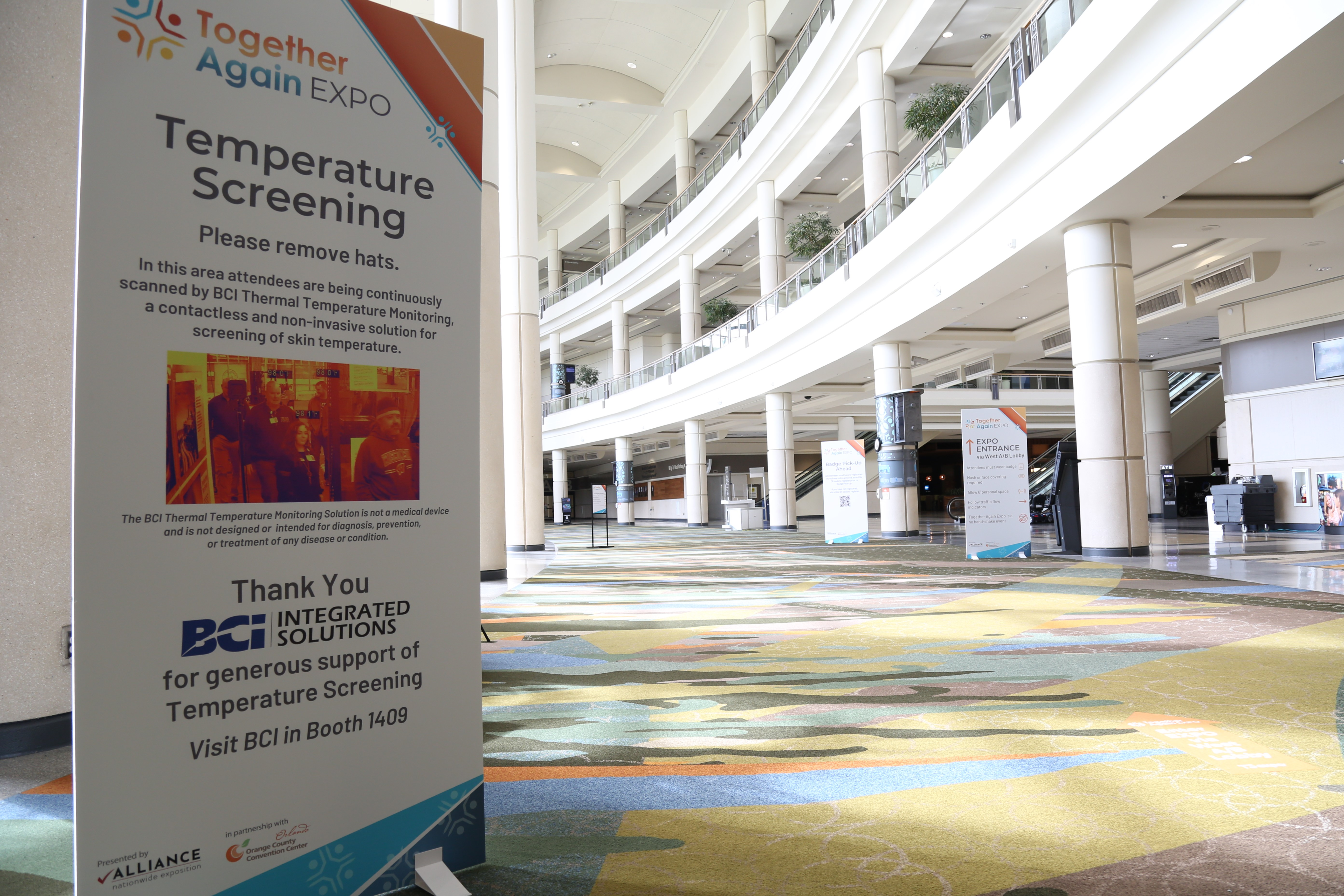 Temperature checking sign in the Orange County Convention Center West Central Lobby at the Together Again Expo